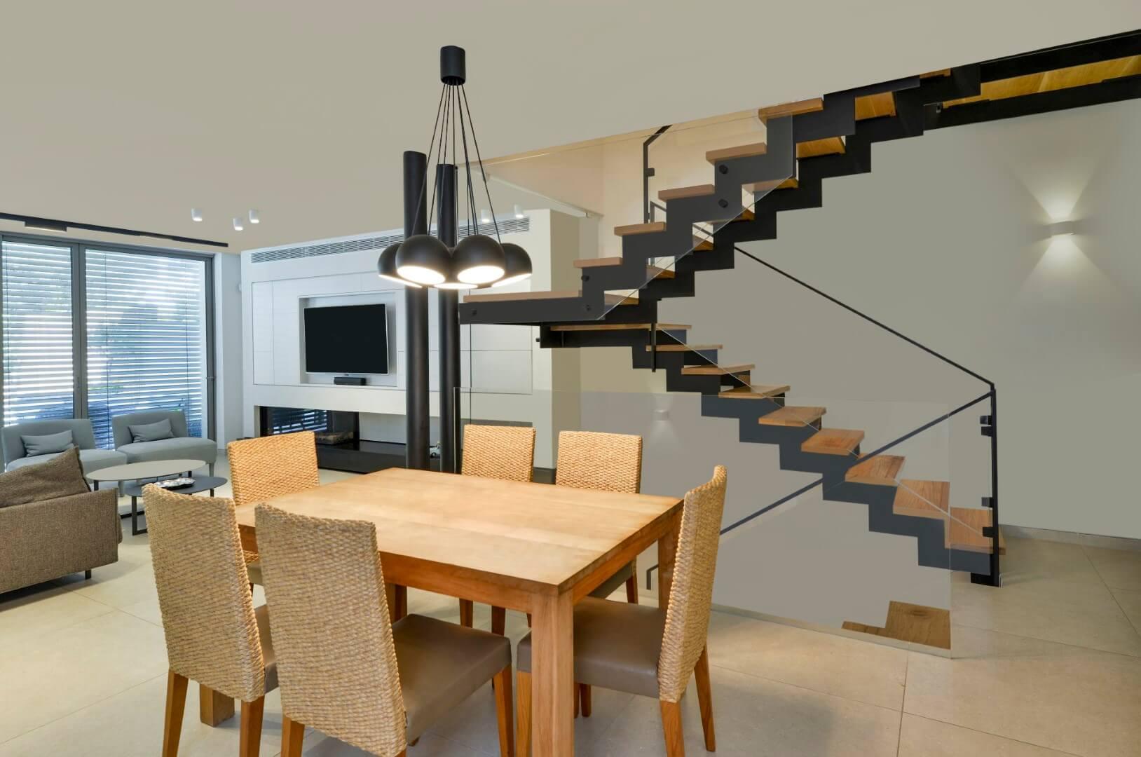 מדרגות עץ וברזל שחור עולים למעלה וחולפים על פני פינת האוכל הביתית